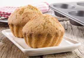 freshly baked muffins on cream colored plate